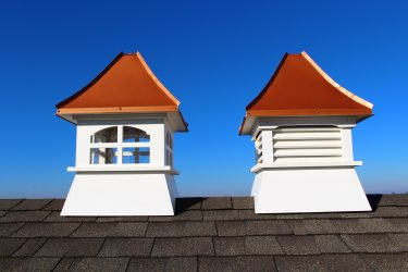 white composite cupolas with copper colored roof