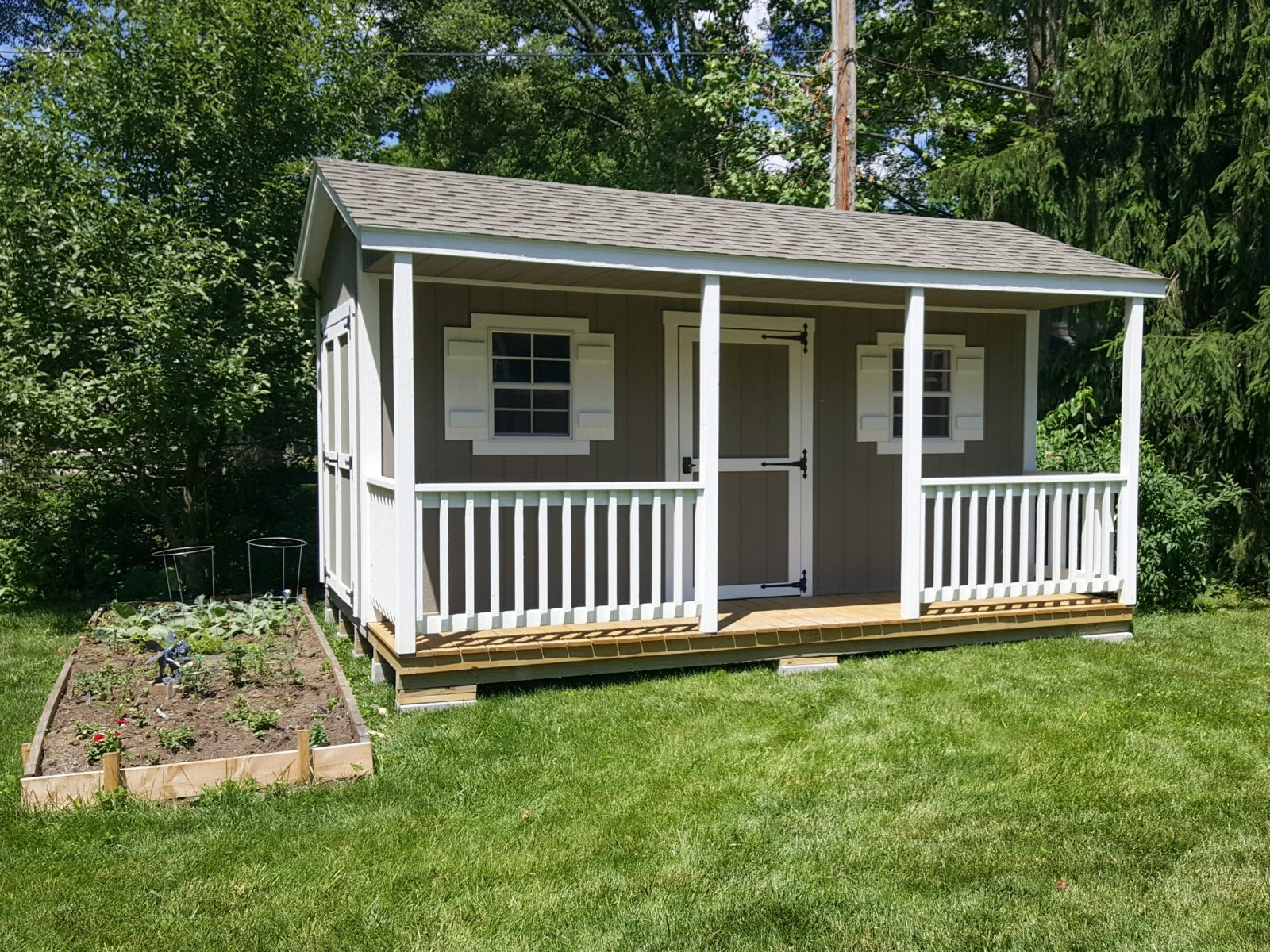 cabin shed with porch used as garden shed in central ohio